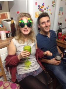 Roo, at a house party, in silly Christmas Tree shaped glasses
