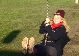 Roo on a zipwire, laughing and smiling her heart out